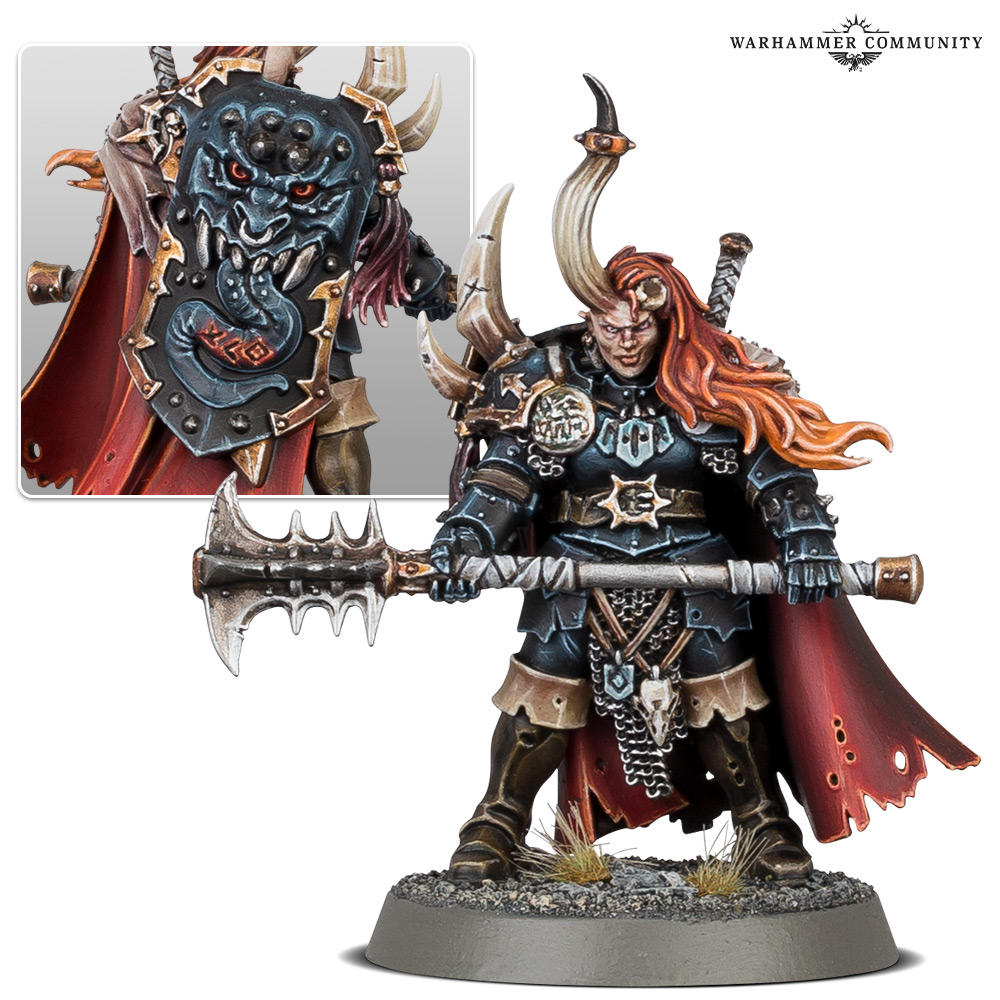 A model of a smirking female chaos champion, carrying a massive two-handed mace.