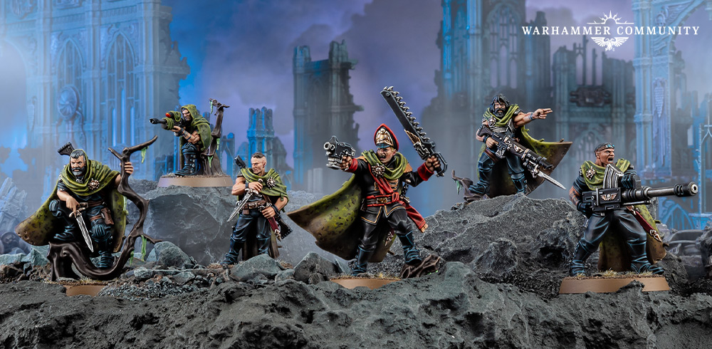 Five models of the characters from the Gaunts Ghosts books, men with long camouflage cloaks.